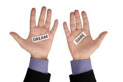 Hand Hold Paper With Dream Dare Writing. Isolated over white background Royalty Free Stock Photo
