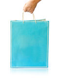 Hand hold paper shopping bag. On reflect white floor Stock Photos