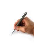 Hand hold a pen writing Stock Photos