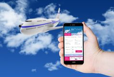 Hand hold a phone with flight tickets on a screen. On the background of a plane in the sky. All screen graphics are made up Royalty Free Stock Photo