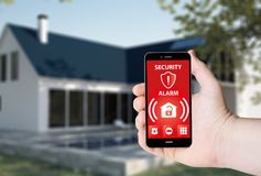Hand hold a phone with system smart house on a screen. Hand hold a phone with security alarm app on a screen on the background of a house. All screen graphics Stock Image