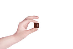 Hand hold pieces of chocolate. Stock Photos