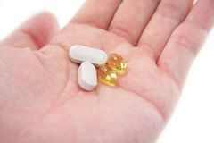 Hand hold pills Stock Photography