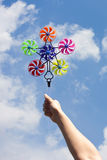 Hand hold pinwheel on blue sky Stock Photos