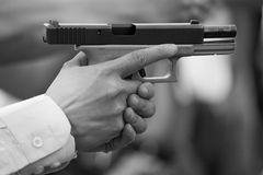 Hand hold pistol and slide back Stock Photos