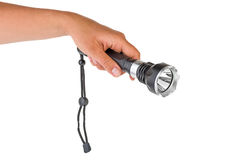 Hand hold powerful LED flashlight Stock Images