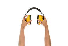 Hand hold Protective ear muffs Isolated Royalty Free Stock Image