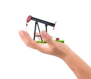 Hand hold pumpjack Royalty Free Stock Photos