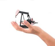 Hand hold pumpjack Stock Photography