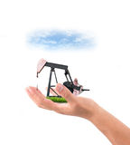 Hand hold pumpjack Royalty Free Stock Photo