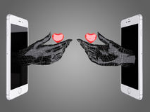 Hand hold the red heart out of a smart phone. Stock Photos
