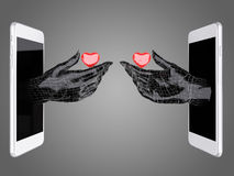 Hand hold the red heart out of a smart phone. Royalty Free Stock Images