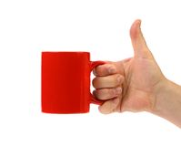 Hand hold red mug. Stock Images