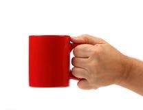 Hand hold red mug. Stock Image