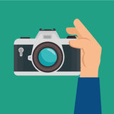 Hand hold retro camera green background design graphic Royalty Free Stock Photo