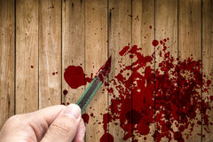 Hand hold rusty knife cutter with grunge of blood on wood Stock Photography