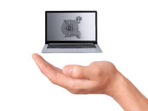 Hand hold security Laptop. Data security concept. Stock Photo