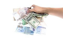 Hand hold the several kind of bank notes and coin Royalty Free Stock Photography