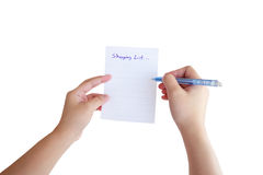 Hand hold shopping list paper. Isolated on white background Stock Image
