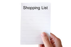 Hand hold shopping list paper. Isolated on white background Stock Photography