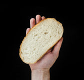 Hand hold a slice of bread. Royalty Free Stock Images
