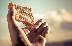 Hand hold a slice of bread. stock image