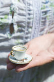 Hand hold small cup of coffee Royalty Free Stock Images
