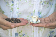 Hand hold small cup of coffee Royalty Free Stock Image
