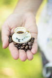 Hand hold small cup of coffee Royalty Free Stock Photos
