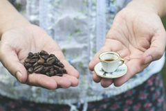Hand hold small cup of coffee Stock Photography