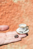 Hand hold small cup of coffee Stock Photos