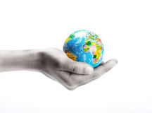 Hand hold small globe Stock Images