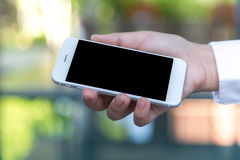 Hand hold Smart Phone Stock Images