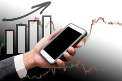 Hand hold smart phone with business graph. S Royalty Free Stock Photography