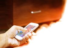 A man use the smartphone in orange lamp royalty free stock image