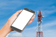 Hand hold smart phone on soft Telecommunication tower Stock Photos