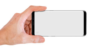 Hand Hold Smartphone for snapping a picture Royalty Free Stock Images