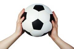 Hand hold soccer ball. On white stock photo
