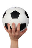 Hand hold soccer ball. On white Stock Images