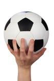 Hand hold soccer ball. On white stock images