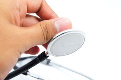 Hand hold stethoscope. Hand hold bell stethoscope on white background Stock Image