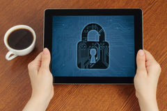 Hand hold tablet pc with lock Royalty Free Stock Image