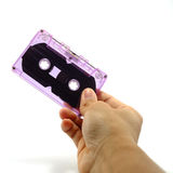 Hand hold tape cassette Royalty Free Stock Photos