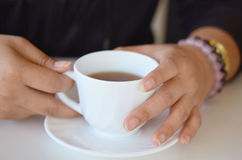 Hand hold tea cup Stock Photo
