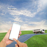 hand hold and touch screen smart phone with airplane in the sky, Stock Photos