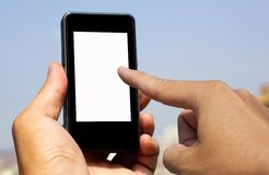 Hand hold and touch smart phone. With blank screen stock photography