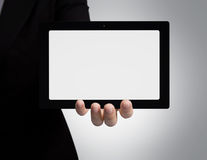 Hand hold touchpad. Royalty Free Stock Image