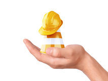 Hand hold traffic cone. Under construction concept Royalty Free Stock Photos