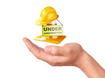 Hand hold traffic cone. Under construction concept Stock Photo
