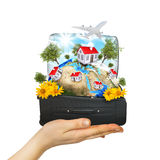 Hand hold travel bag with Earth and buildings Royalty Free Stock Photos